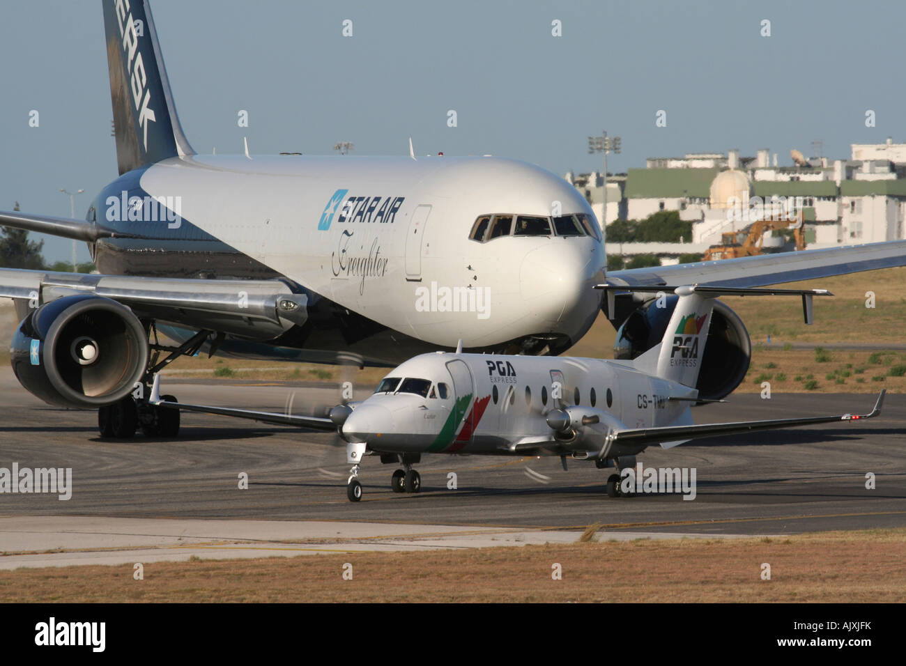 Air traffic. Aircraft queuing for takeoff at Lisbon Portela Airport, Portugal - Stock Image