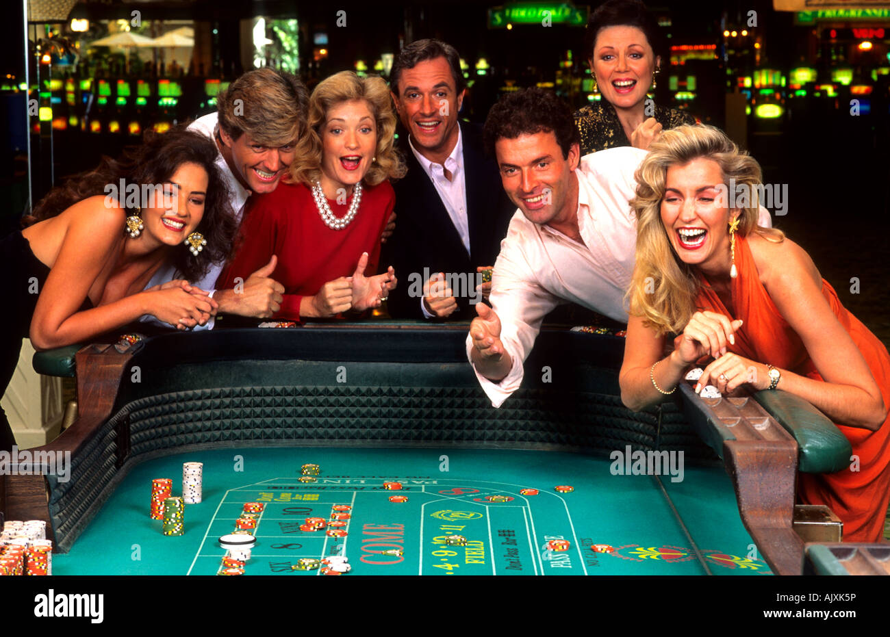 Great excitement in gambling at crap table with chips in lush gambling  casino laughing and having fun Stock Photo - Alamy