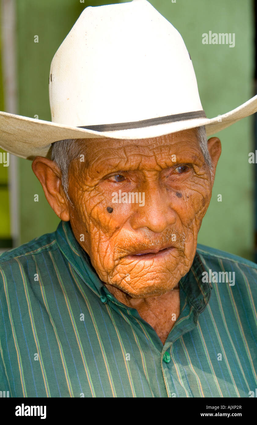Local humble poor man portrait with cowboy hat in Lake Atitlan village of San Pedro Guatemala in Central America - Stock Image