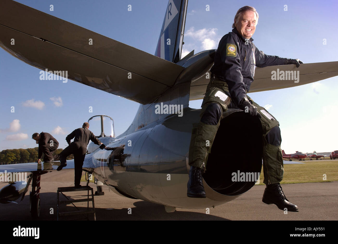 JET PILOT BARRIE PRESCOTT WHO IS A SHAREHOLDER IN A HUNTER TZ RAF TRAINER PICTURED AT KEMBLE GLOUCESTERSHIRE UK - Stock Image