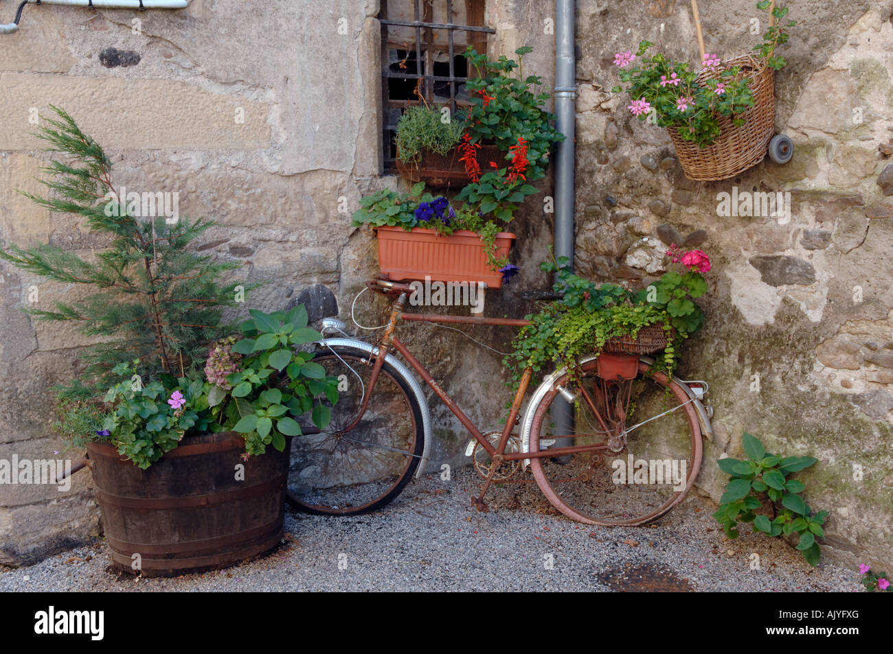 0ld bicycle at Ste Eulalie d Olt in the Aveyron 12 departement of France One of Les Plus Beaux Villages de France - Stock Image