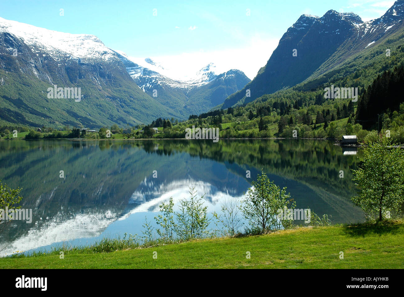 Reflections of mountains in Lake Olden, Norway - Stock Image