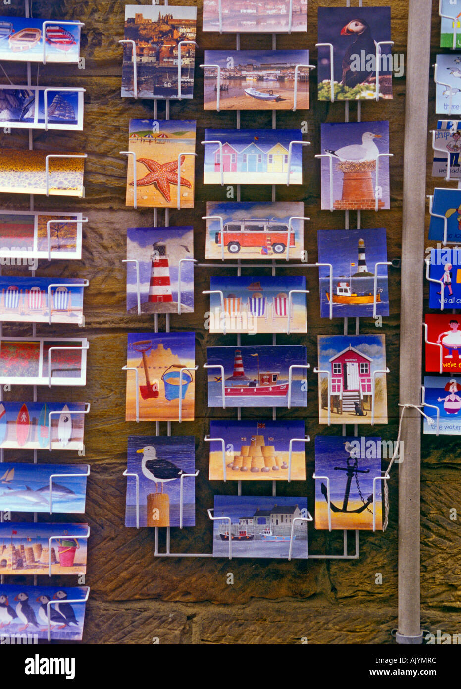 Postcards in a rack in Whitby North Yorkshire - Stock Image