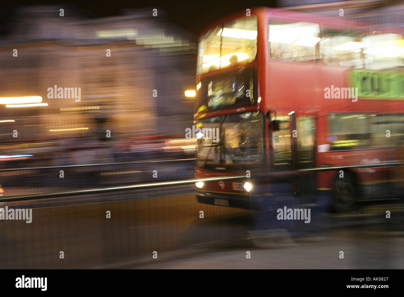 Red London Bus at Night - Stock Image