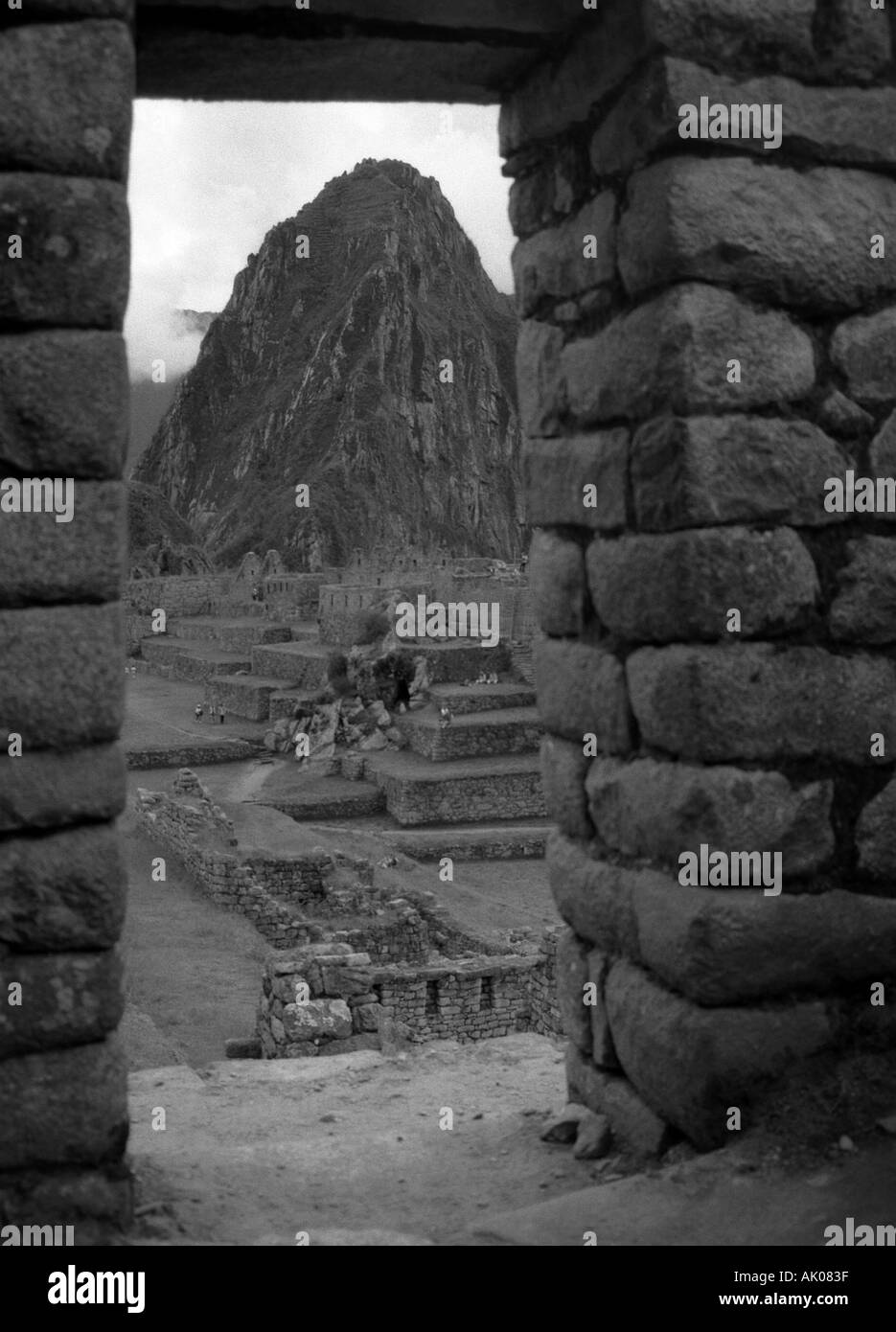 View of Lost City Incas & Huayana Picchu through stone doorway Machu Picchu Cuzco Cusco Peru South Latin America - Stock Image