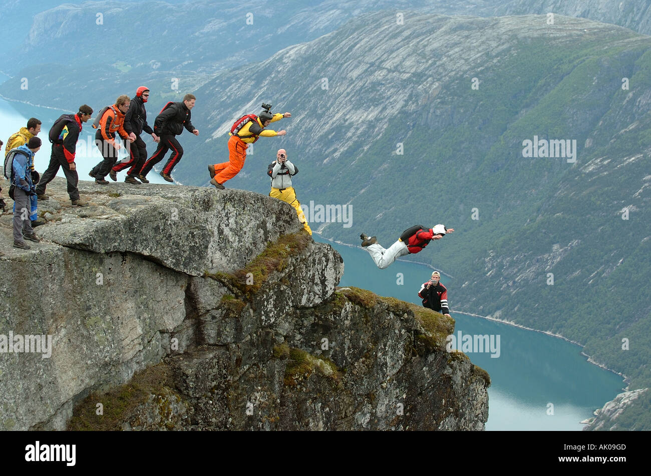 Group of BASE jumpers jumping - Stock Image