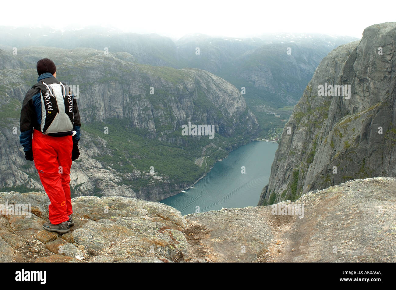 BASE jumper looking over the fjord - Stock Image