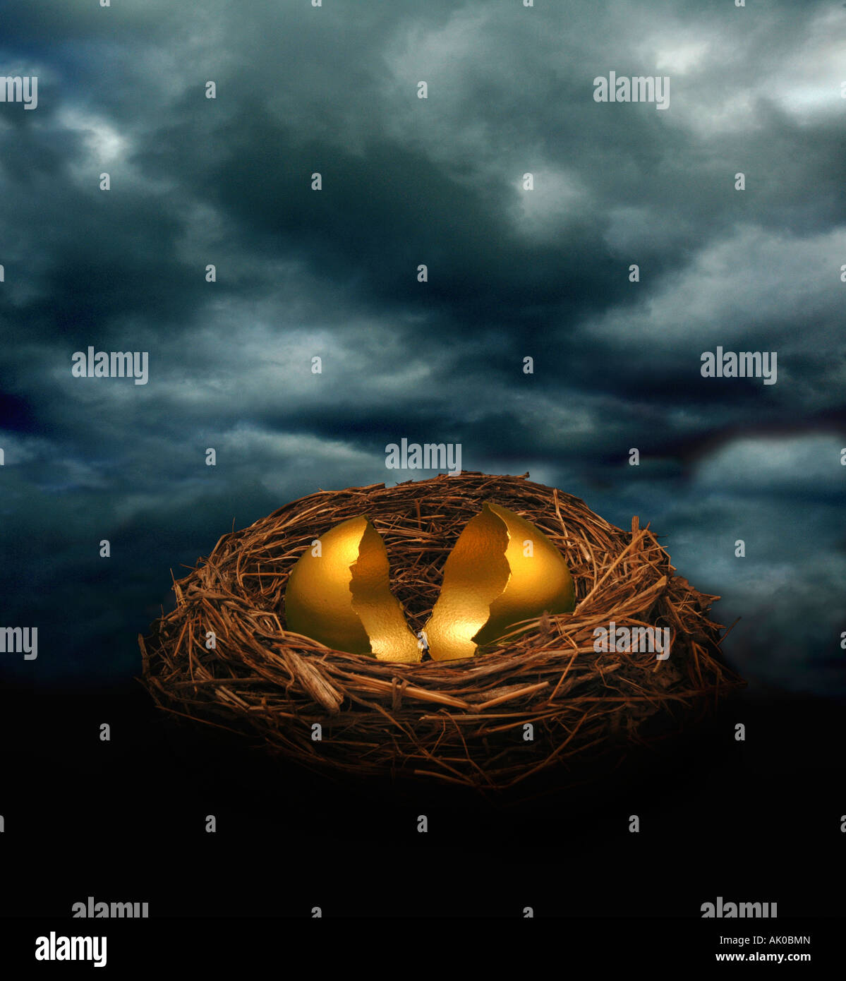 A cracked golden nest egg under a dark cloudy sky Could symbolize financial crash threat or disaster - Stock Image