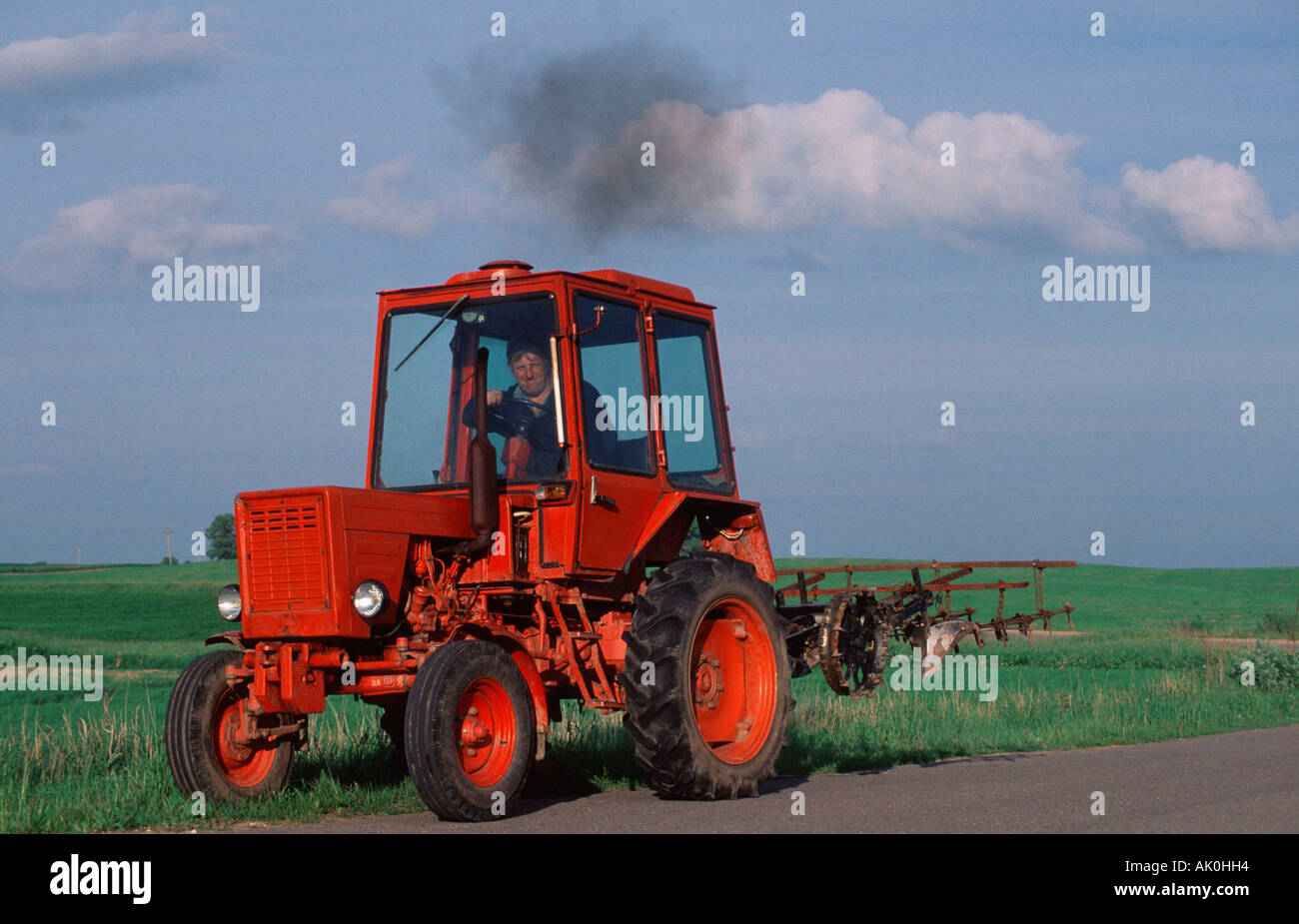 Farmer with tractor / Bauer mit Traktor - Stock Image