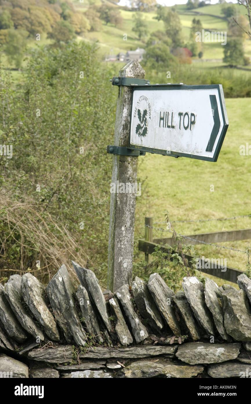 England UK Sawrey Hill Top Beatrix Potter home Peter Rabbit author sign stone wall - Stock Image