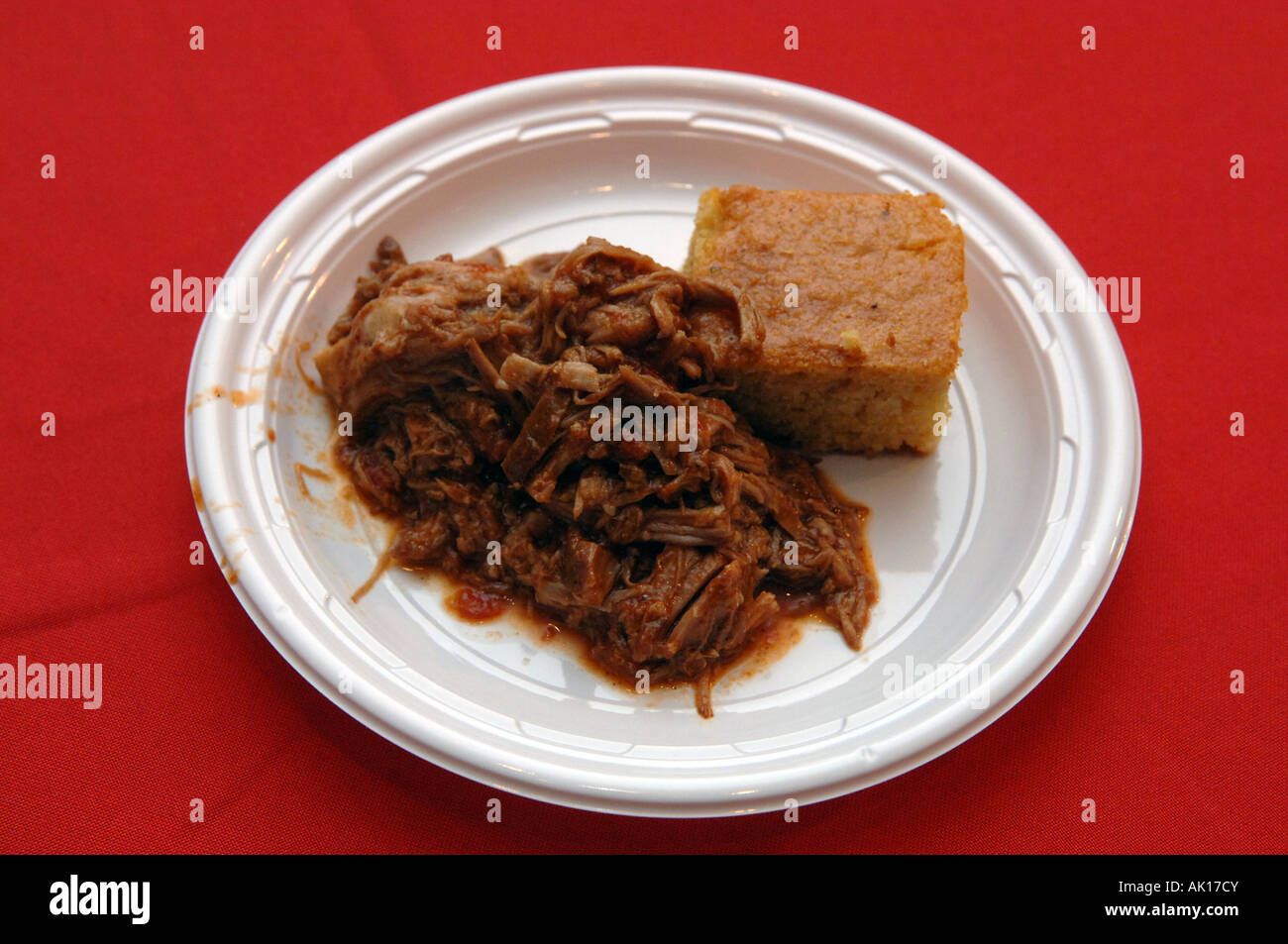 Plate of homemade BBQ pulled pork and cornbread - Stock Image
