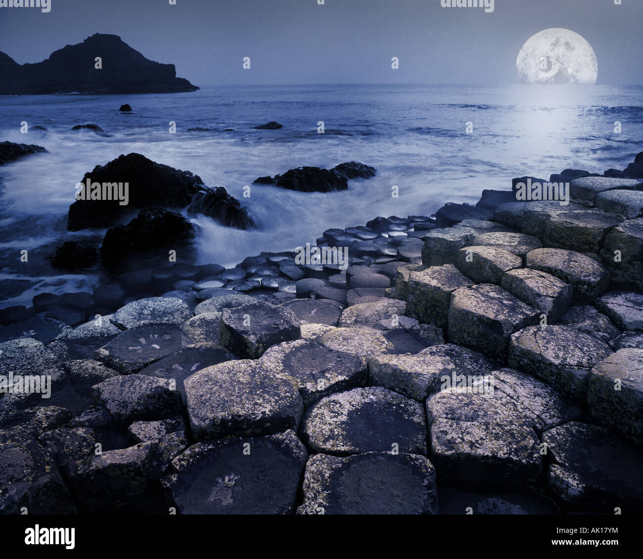GB - NORTHERN IRELAND:  Moon at Giant's Causeway - Stock Image