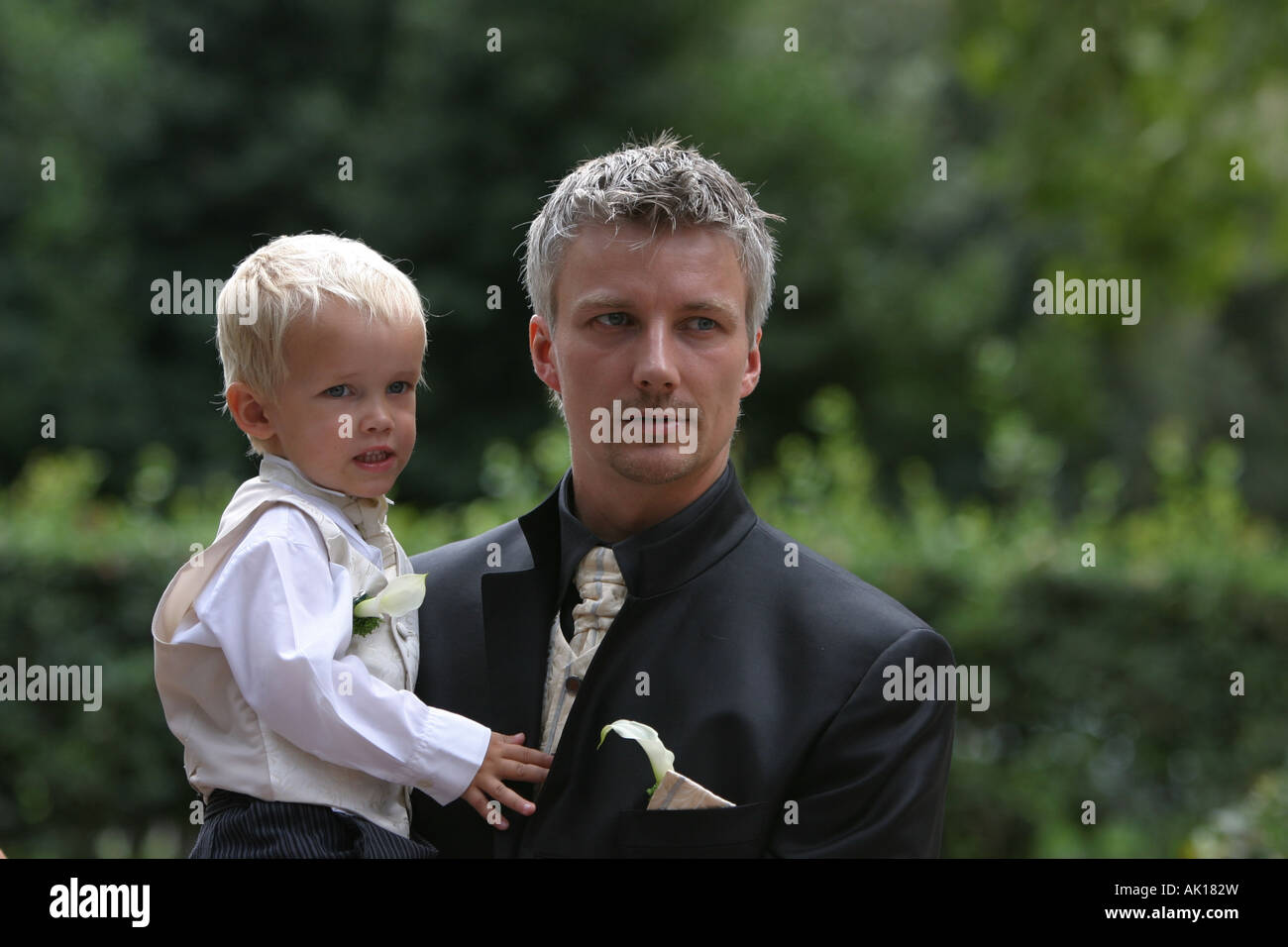 Groom and son. - Stock Image