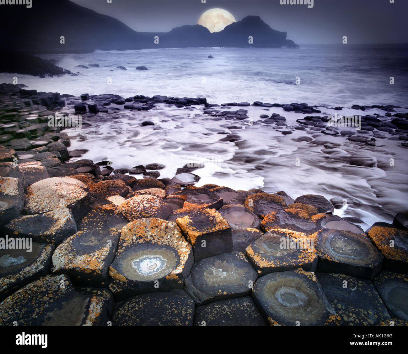 GB - NORTHERN IRELAND:  Moon over Giant's Causeway - Stock Image