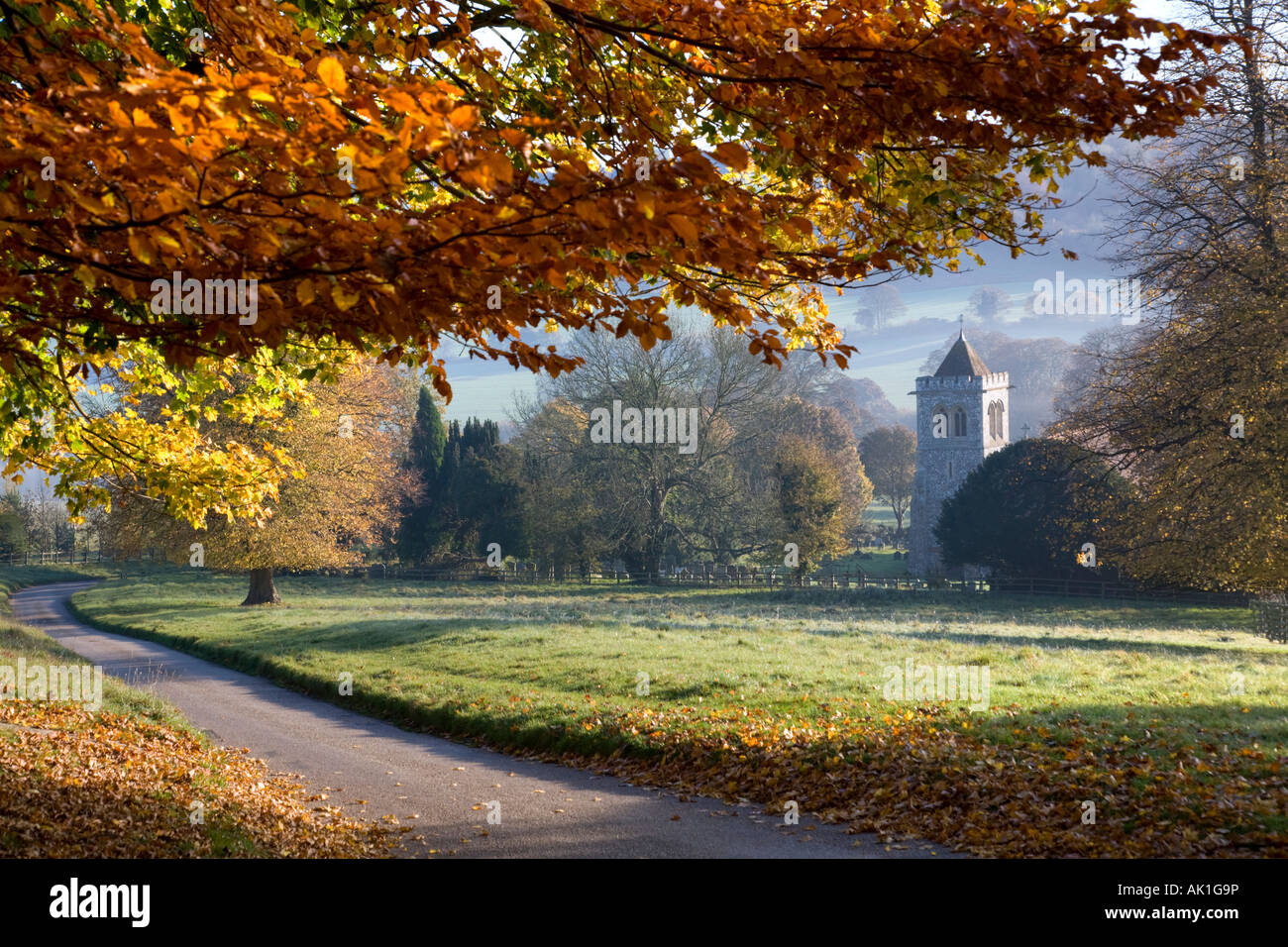 Autumn in Hughenden Valley, High Wycombe, Buckinghamshire, UK. The church is St Michael & All Angels. - Stock Image