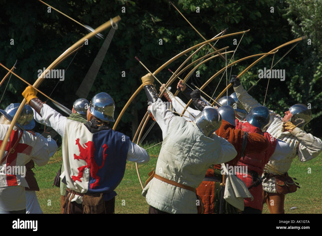Medieval longbow archers reenacting the siege of Berkeley Castle with shooting of voiles of arrows - Stock Image