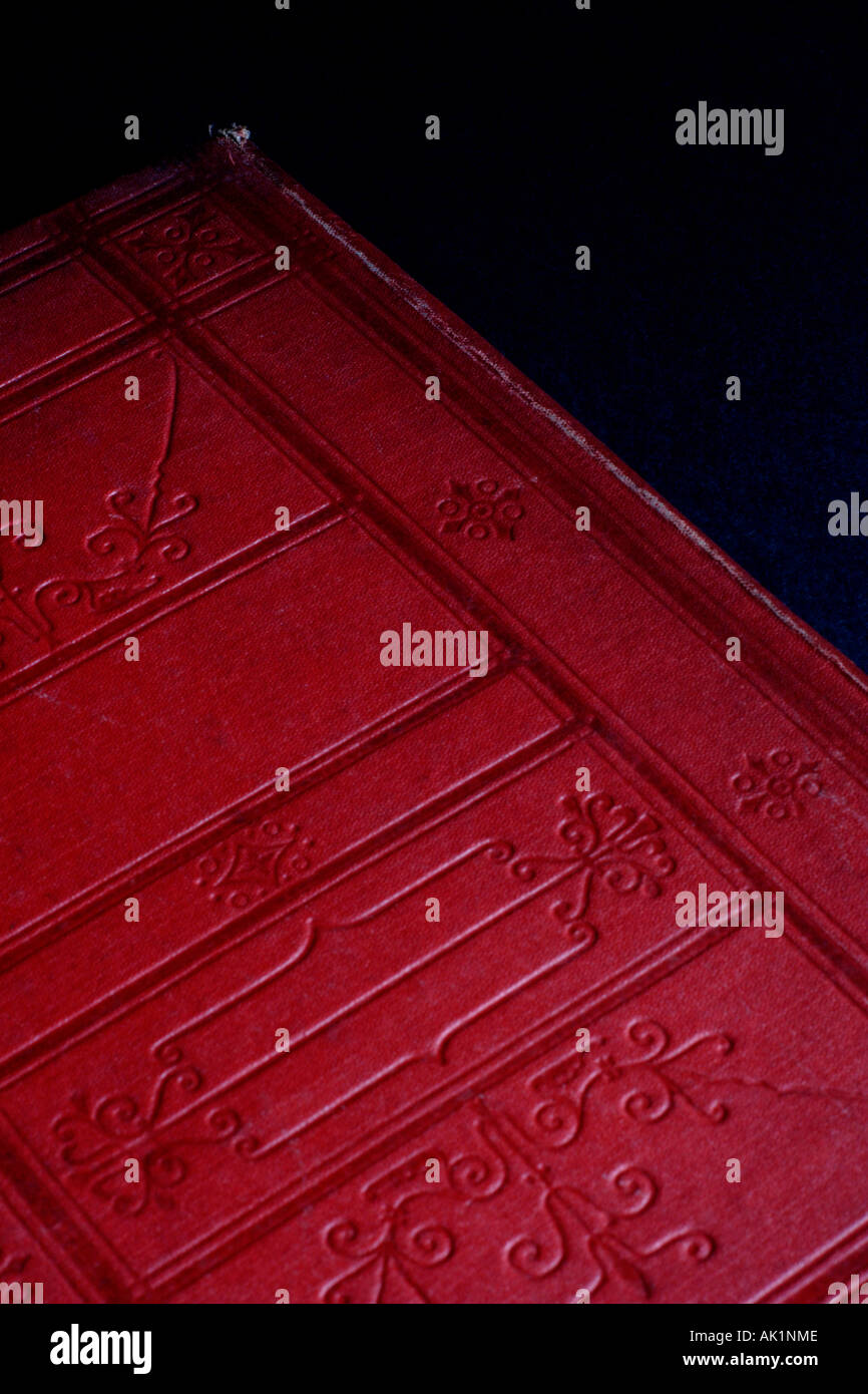 Detail of red leather book cover - Stock Image