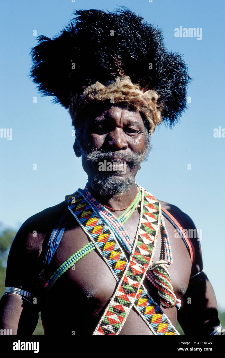 Portrait of a Zulu Chief dressed in traditional dress in Zululand South Africa - Stock Image