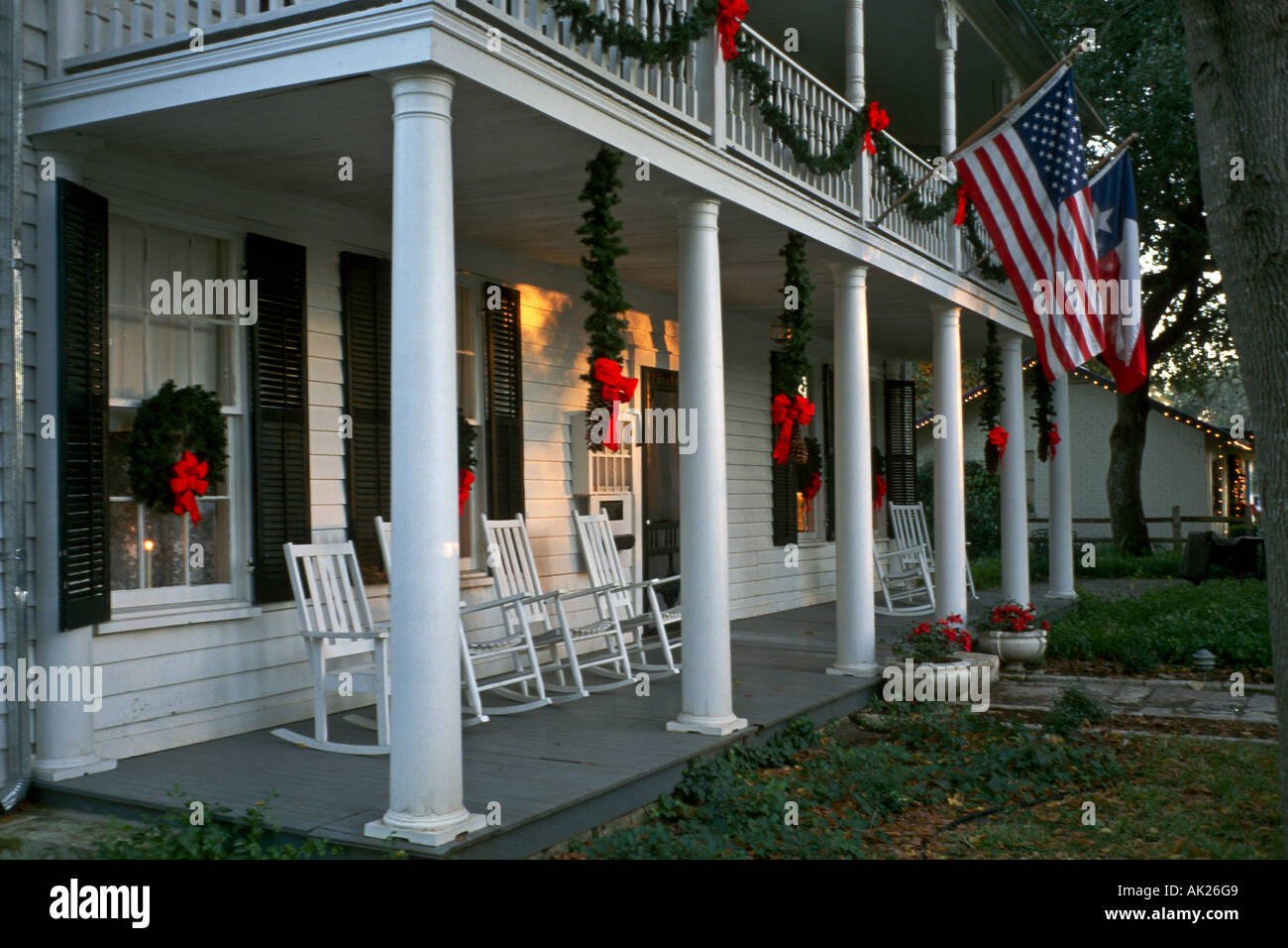 colonial style bed and breakfast home with white columns and rocking