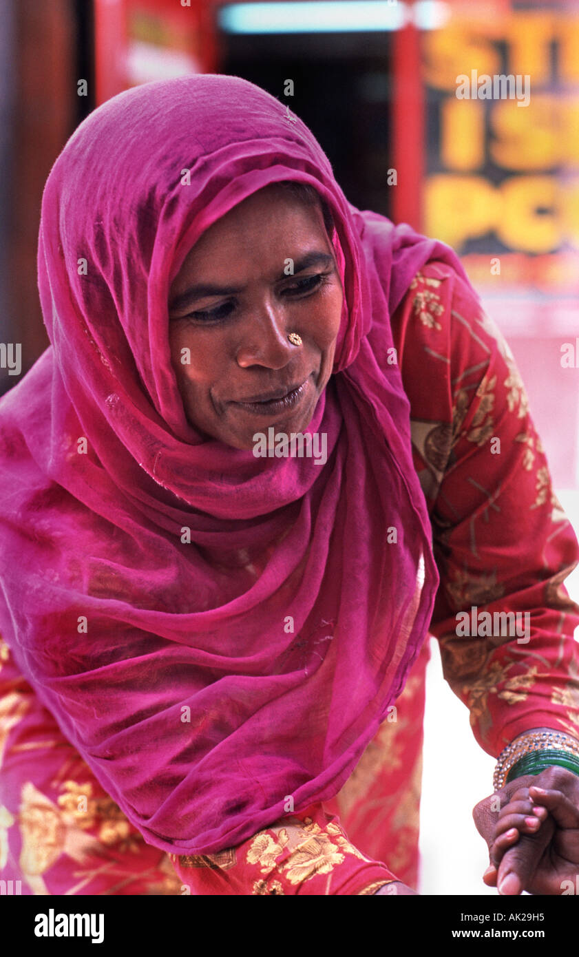 Indian woman in a colourful sari at market Manali Himachal Pradesh India - Stock Image