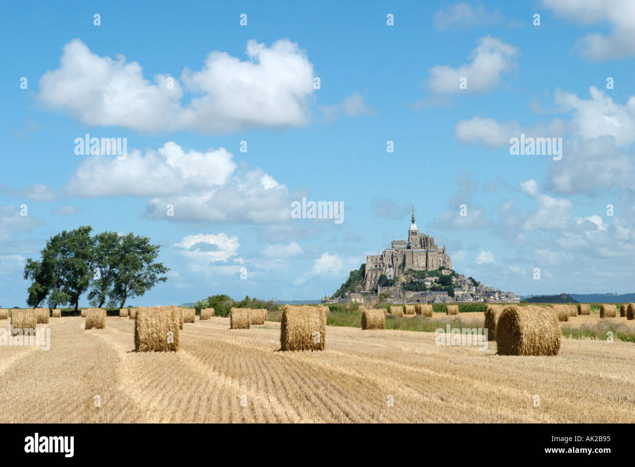 View of Mont Saint-Michel across newly harvested fields, Normandy, France - Stock Image