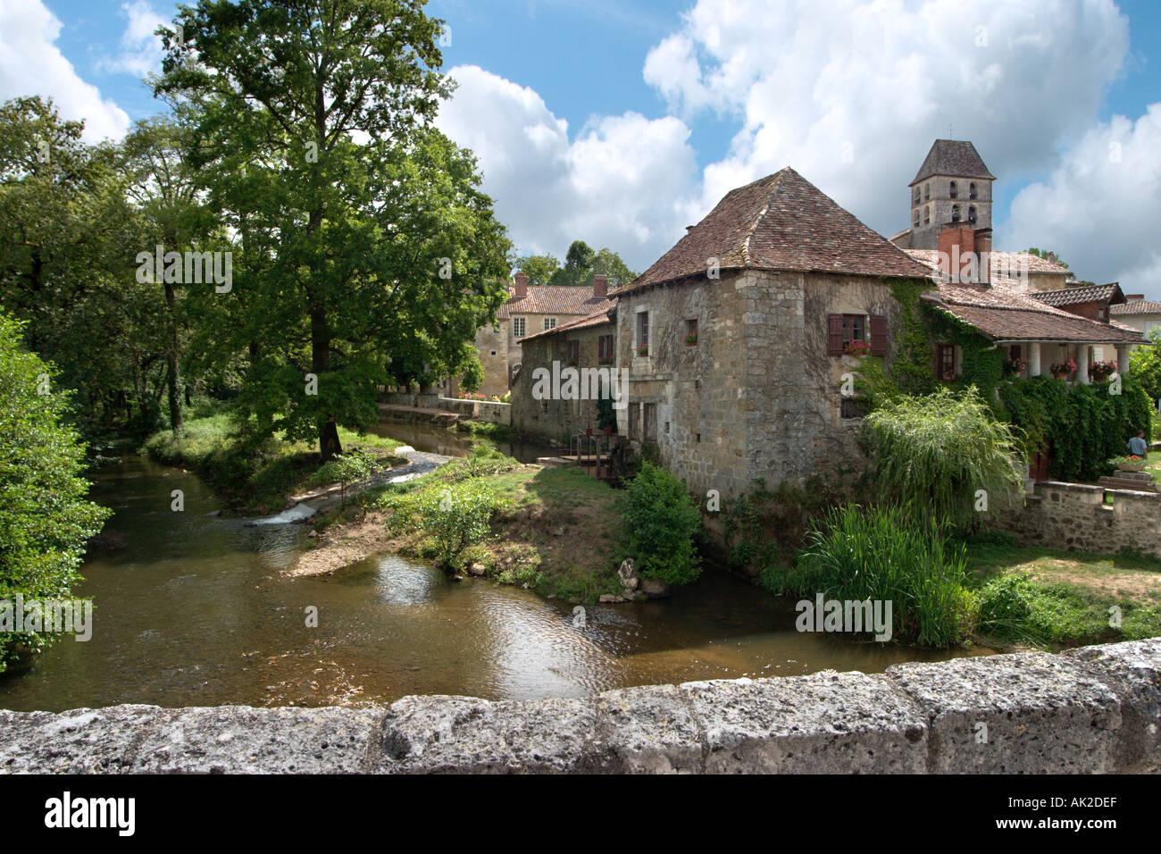 River and Church of St Jean Baptiste, St Jean de Cole, Dordogne, France - Stock Image