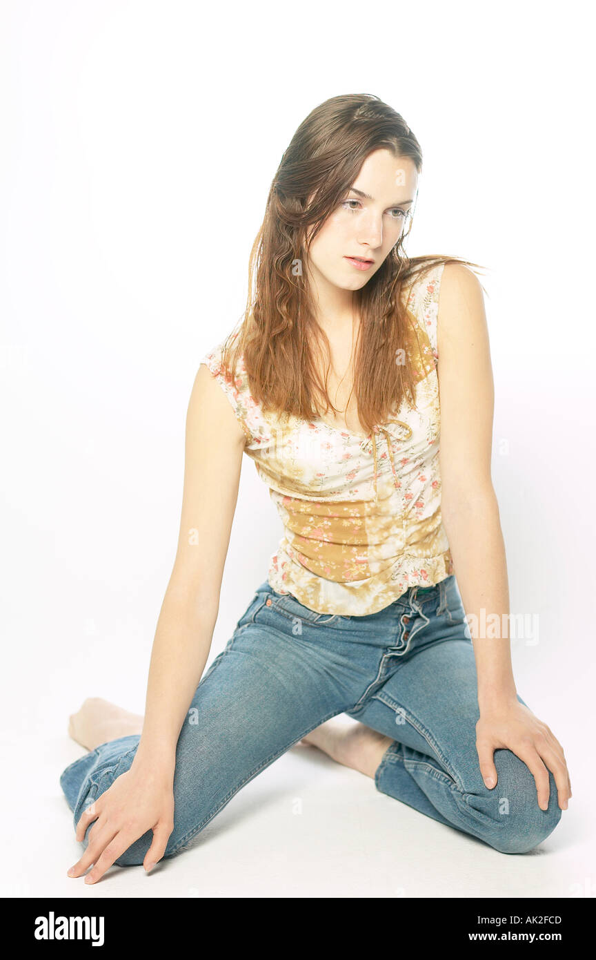 kneeling woman in jeans stock photo 1257420 alamy