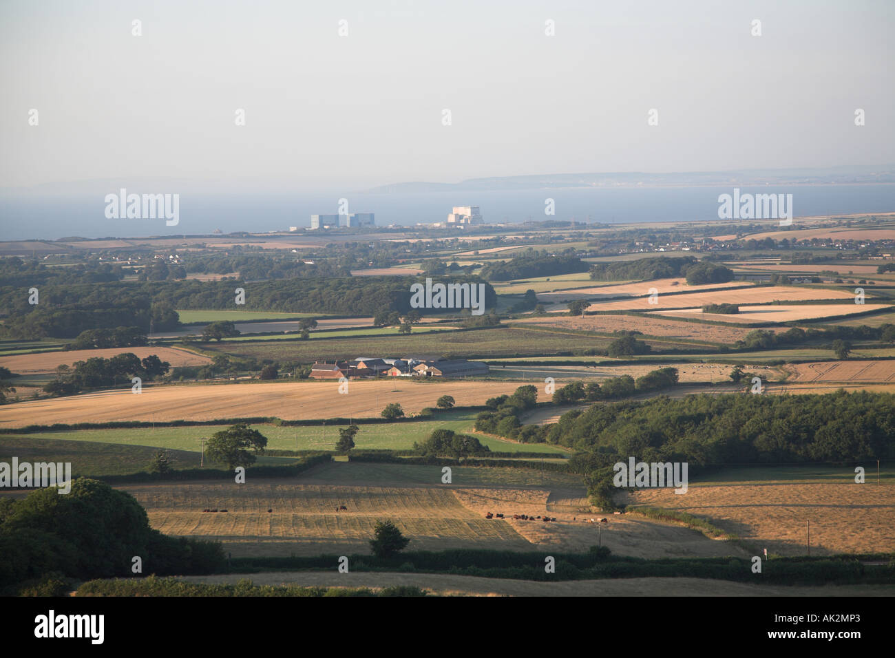 View to Hinkley Point power station and Bristol Channel and South Wales in distance Somerset England Stock Photo