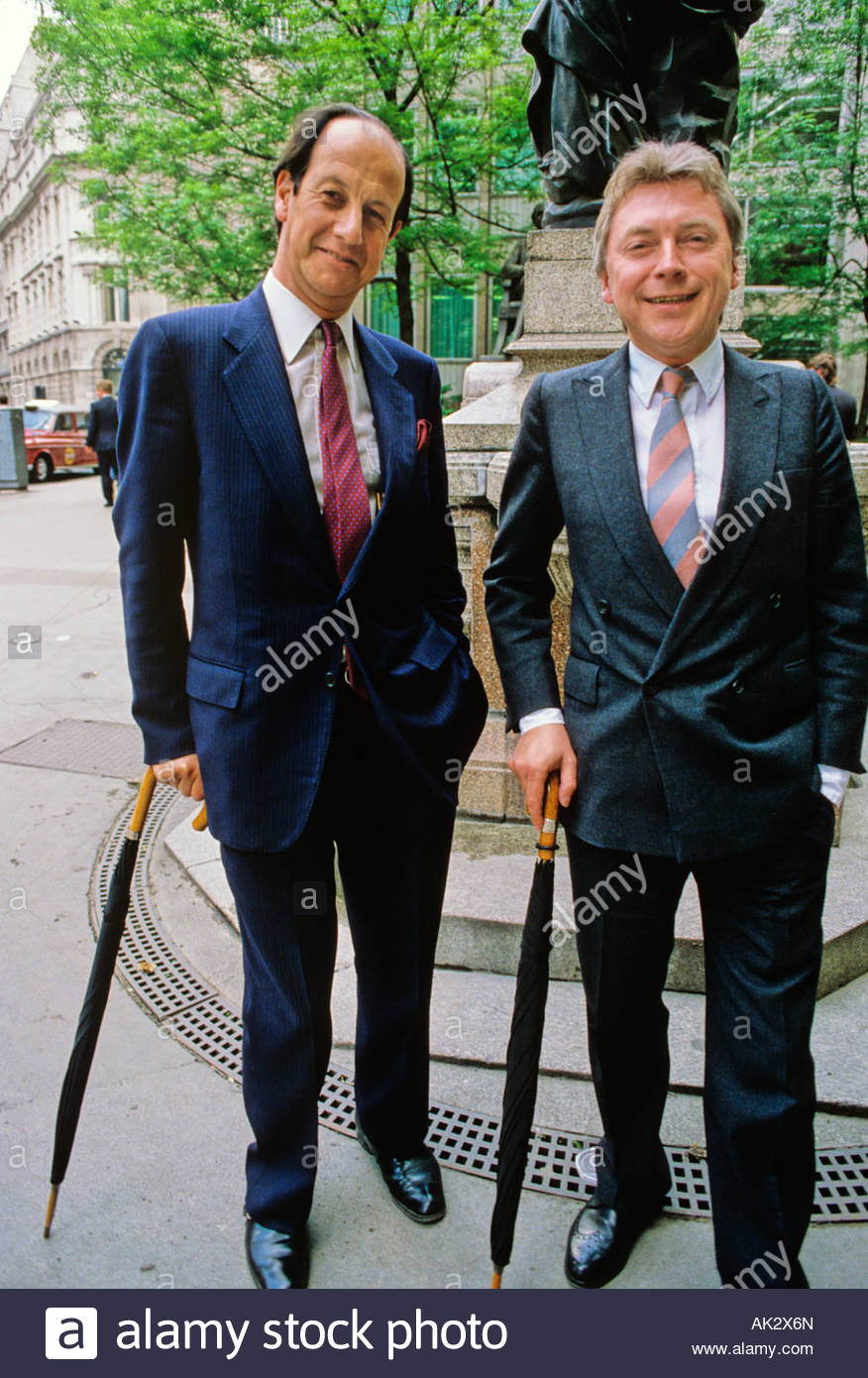 Two English business men with rolled umbrellas; City of London, London England - Stock Image