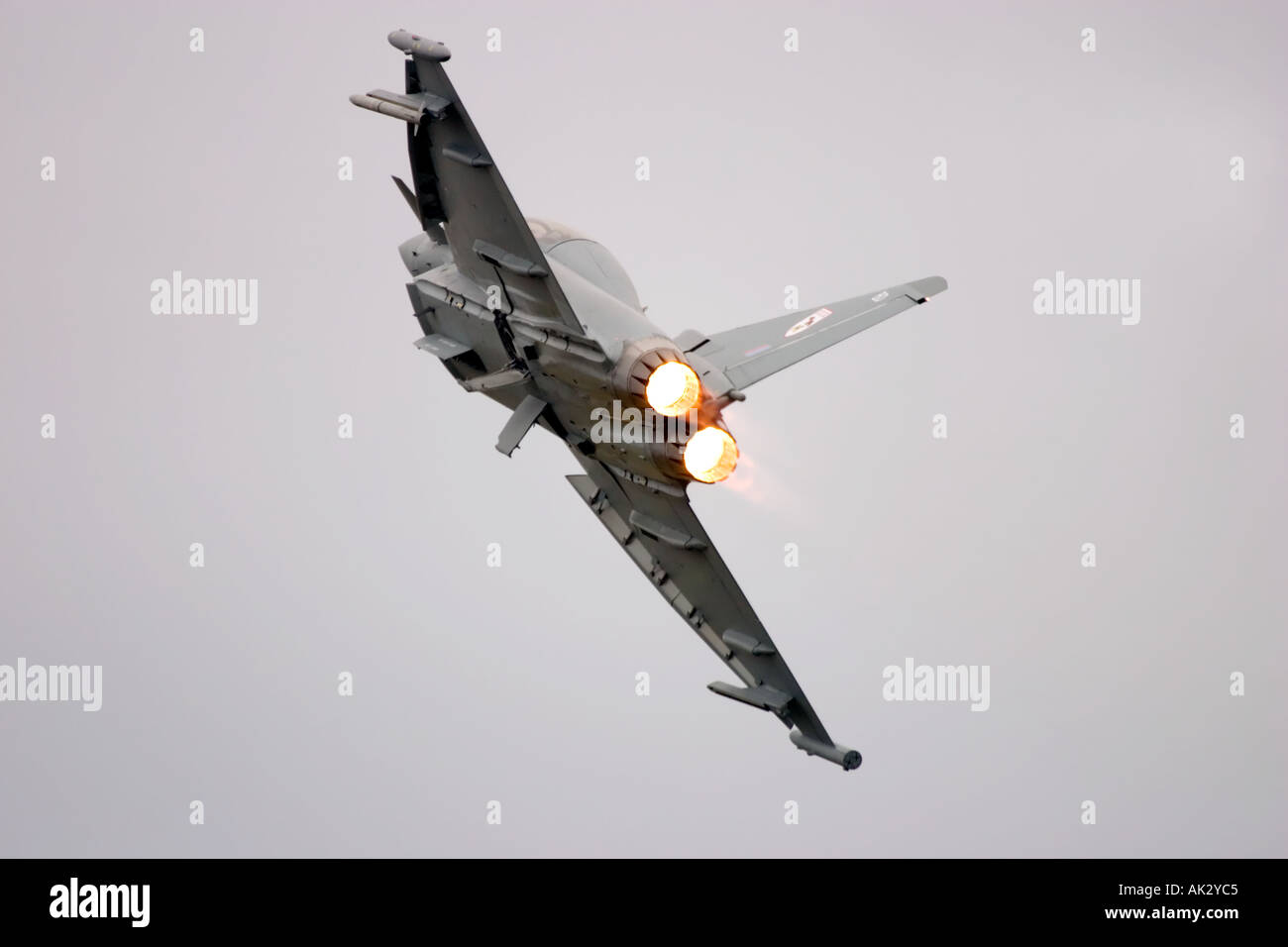 RAF Typhoon T1 29 R Squadron Eurofighter aircraft retracts landing gear wheels after taking off on full afterburner Stock Photo