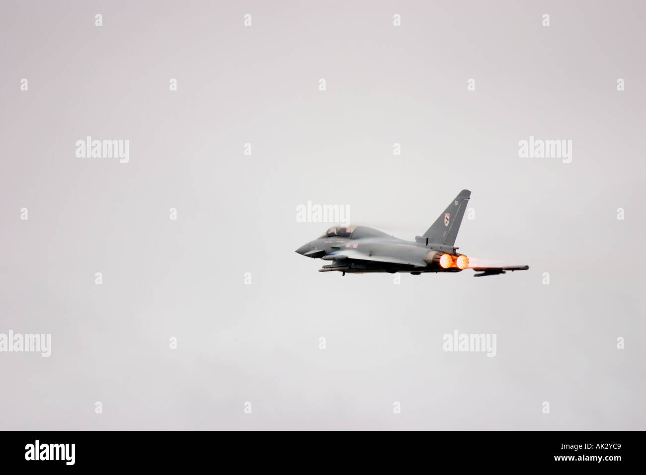 RAF Typhoon T1 29 R Squadron Eurofighter aircraft high speed pass on full afterburner with air condensation bufetting Stock Photo