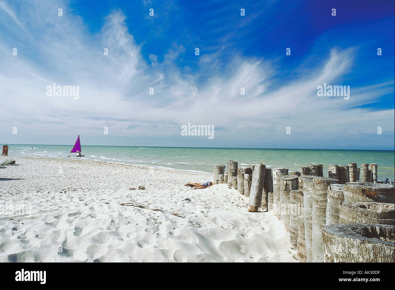 Beach with sailboat in distance Progresso Yucatan Mexico - Stock Image