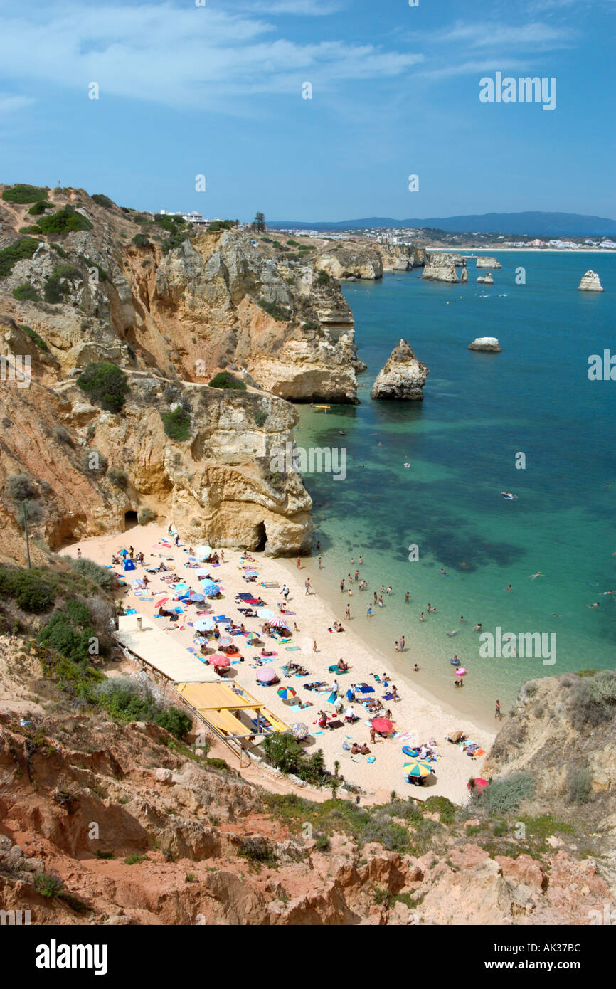 Beach and rock formations at Ponta da Piedade, Lagos, Algarve, Portugal - Stock Image