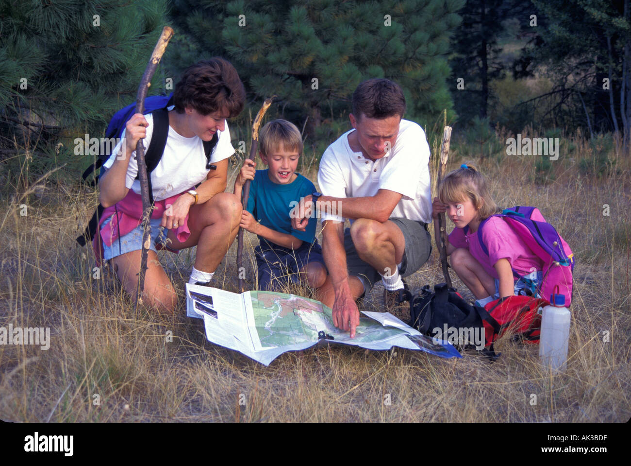 released family hiking navigating using map and compass Stock Photo