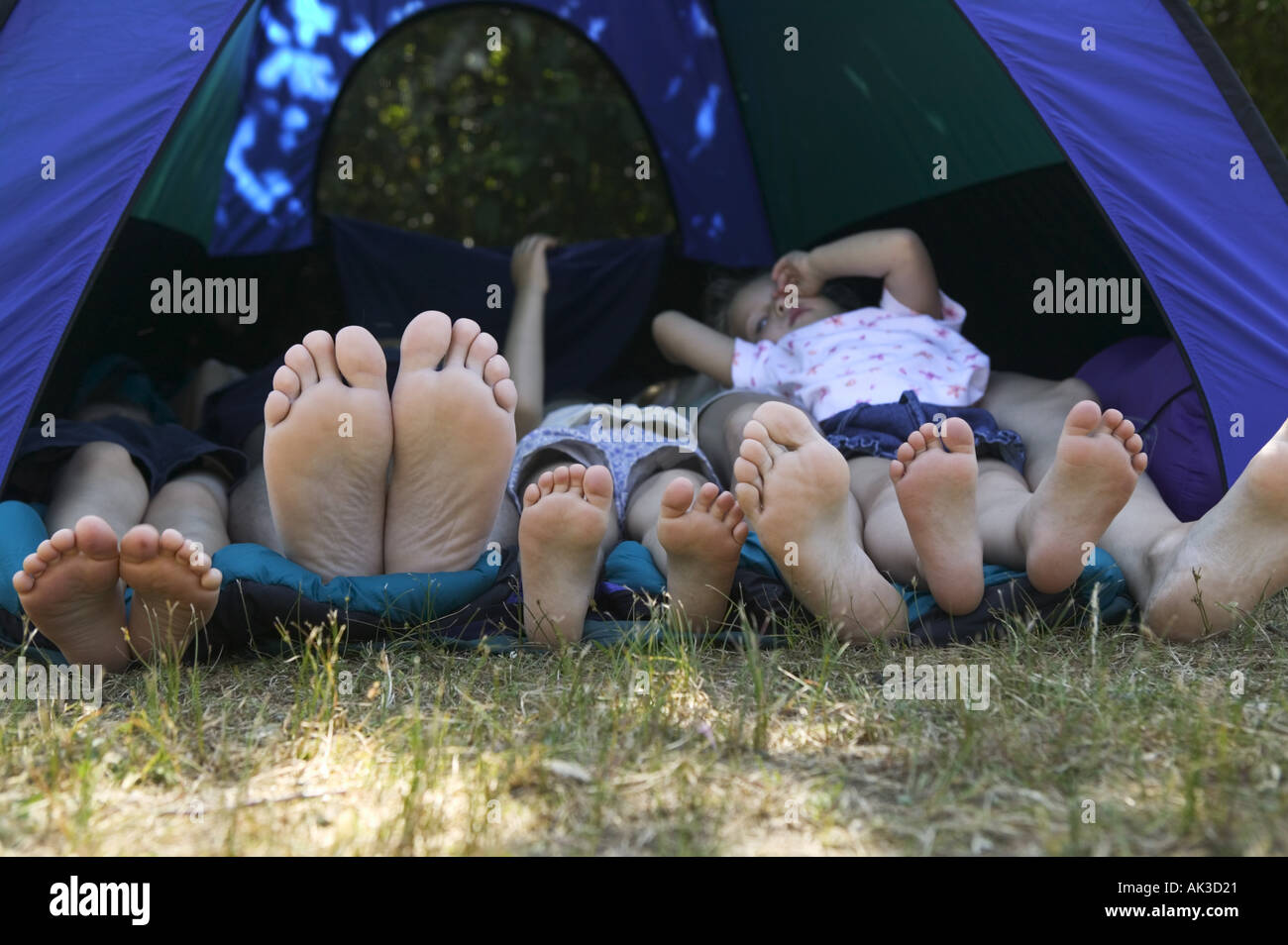 Family s feet sticking out of tent on camping trip Stock ...