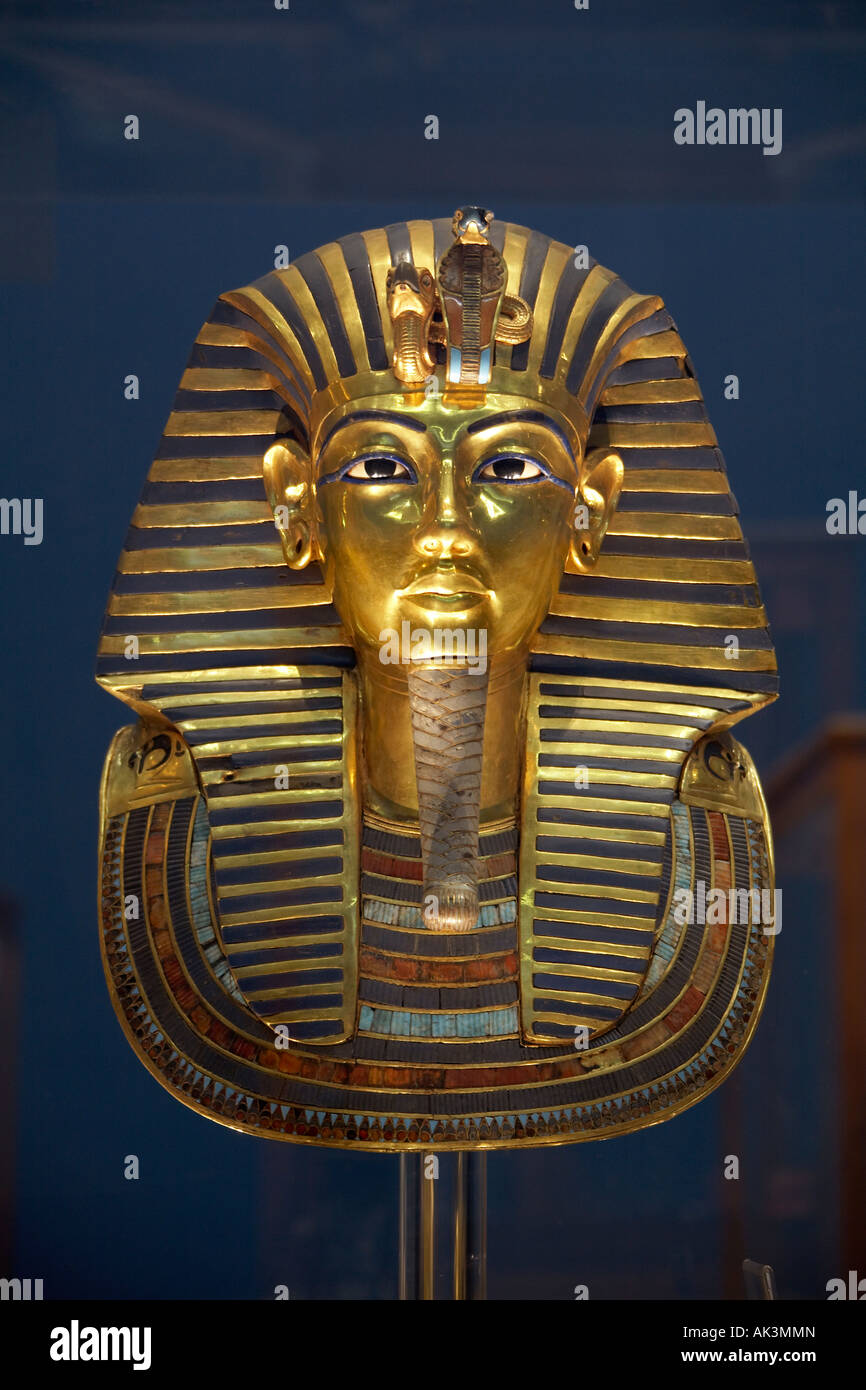 Death Mask of Pharaoh King Tutankhamun made of gold inlaid with coloured glass and semi precious stone The Egyptian - Stock Image
