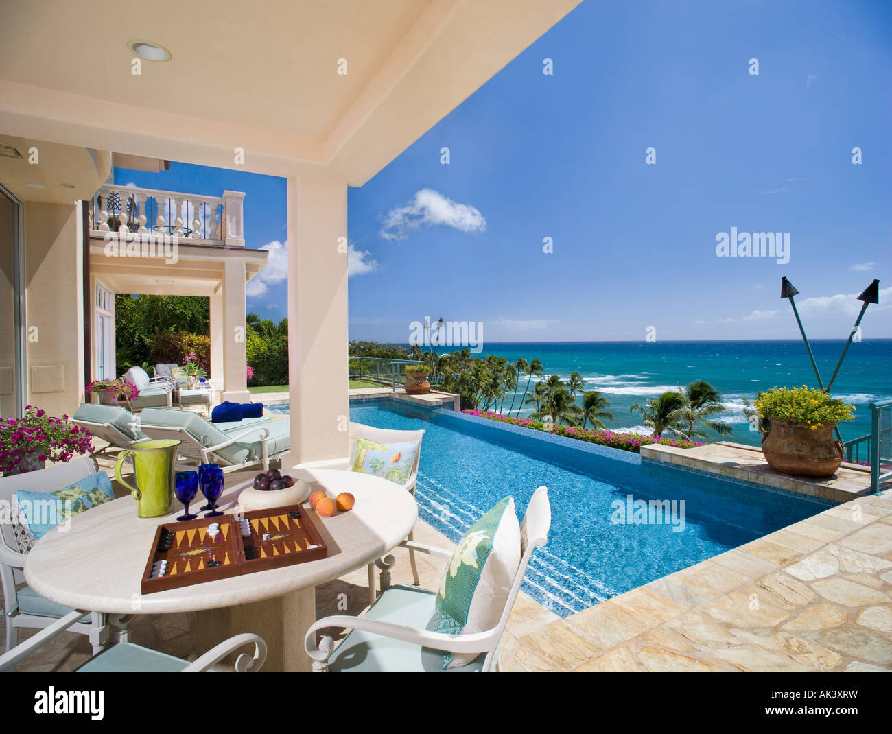 Large Swimming Pool and Deck in Coastal Mansion Stock Photo