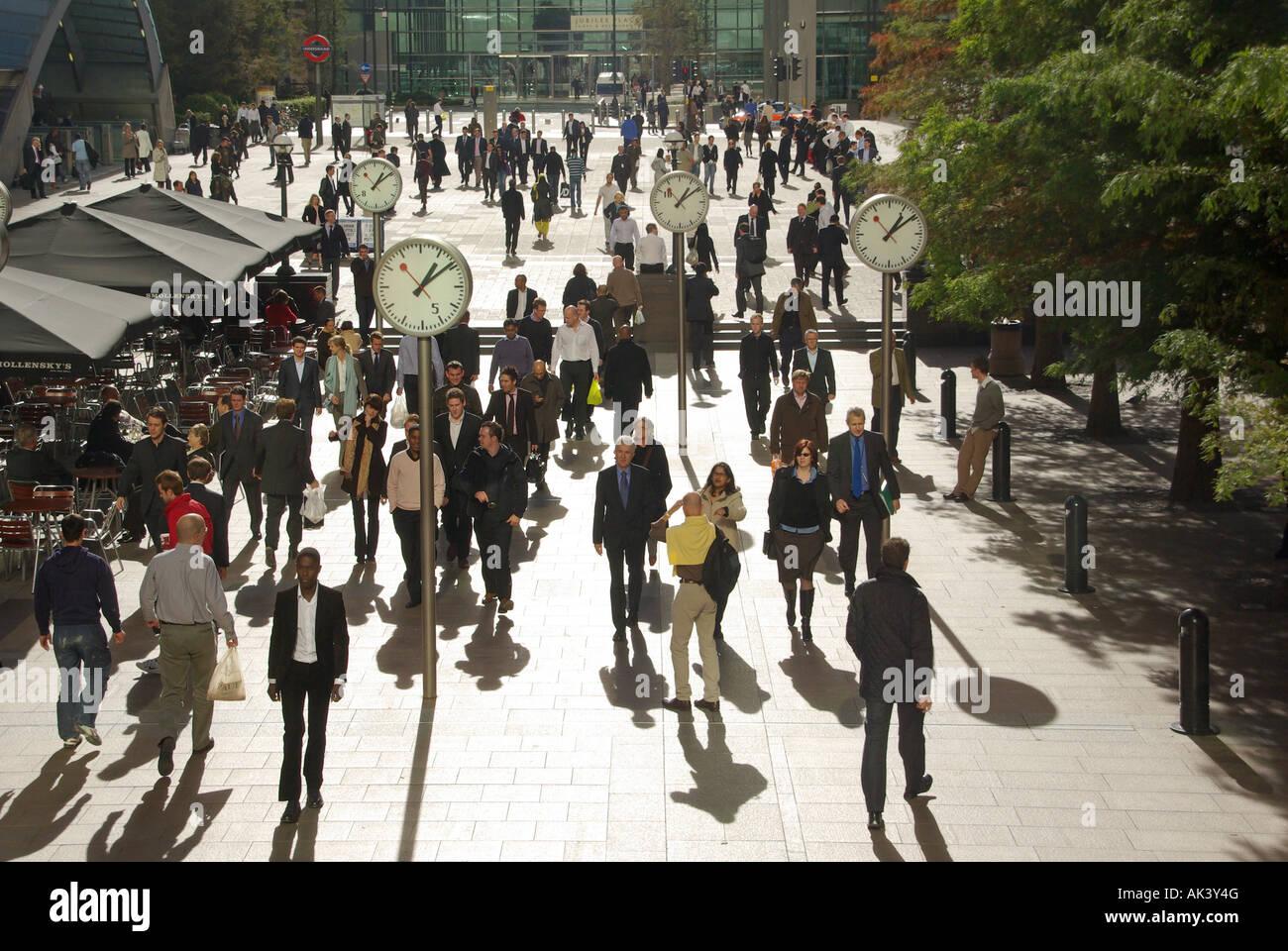 London Docklands Canary Wharf clocks and pavement bar parasols - Stock Image