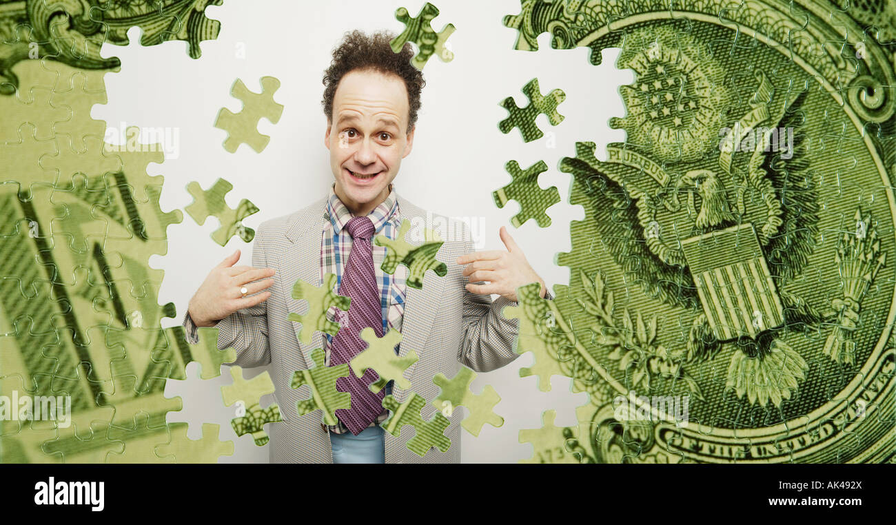 Composite of a US dollar bill and a goofy business man - Stock Image