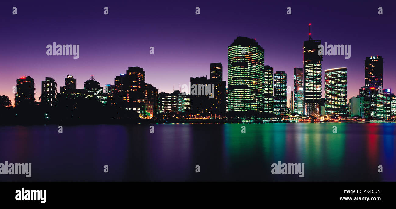Australia. Queensland. Brisbane. City skyline by night from across the Brisbane River. - Stock Image