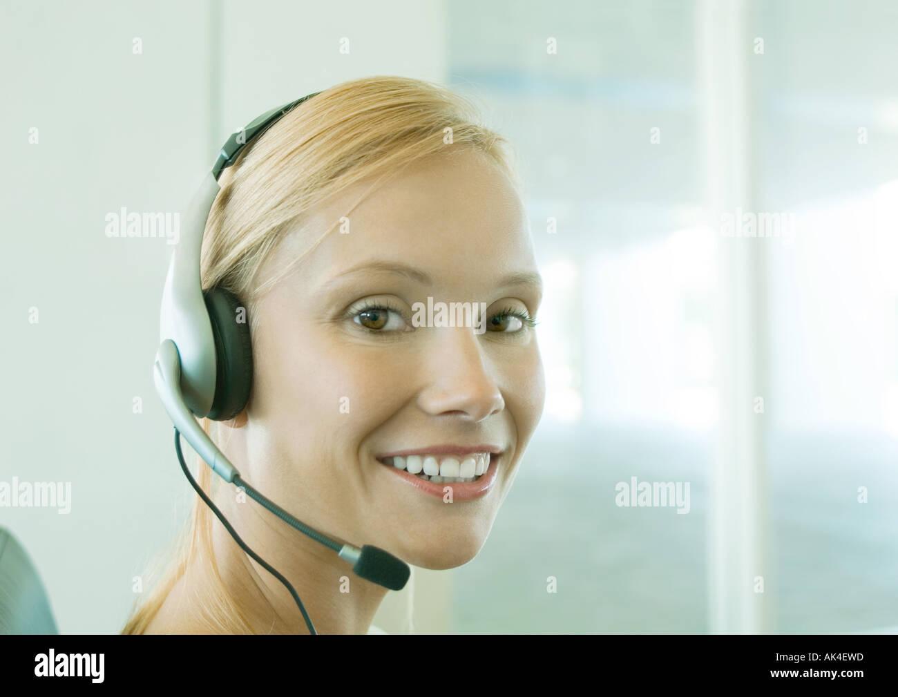 Woman wearing headset - Stock Image