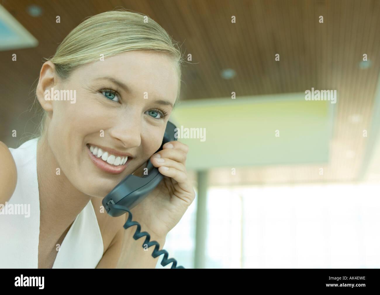 Woman using telephone - Stock Image