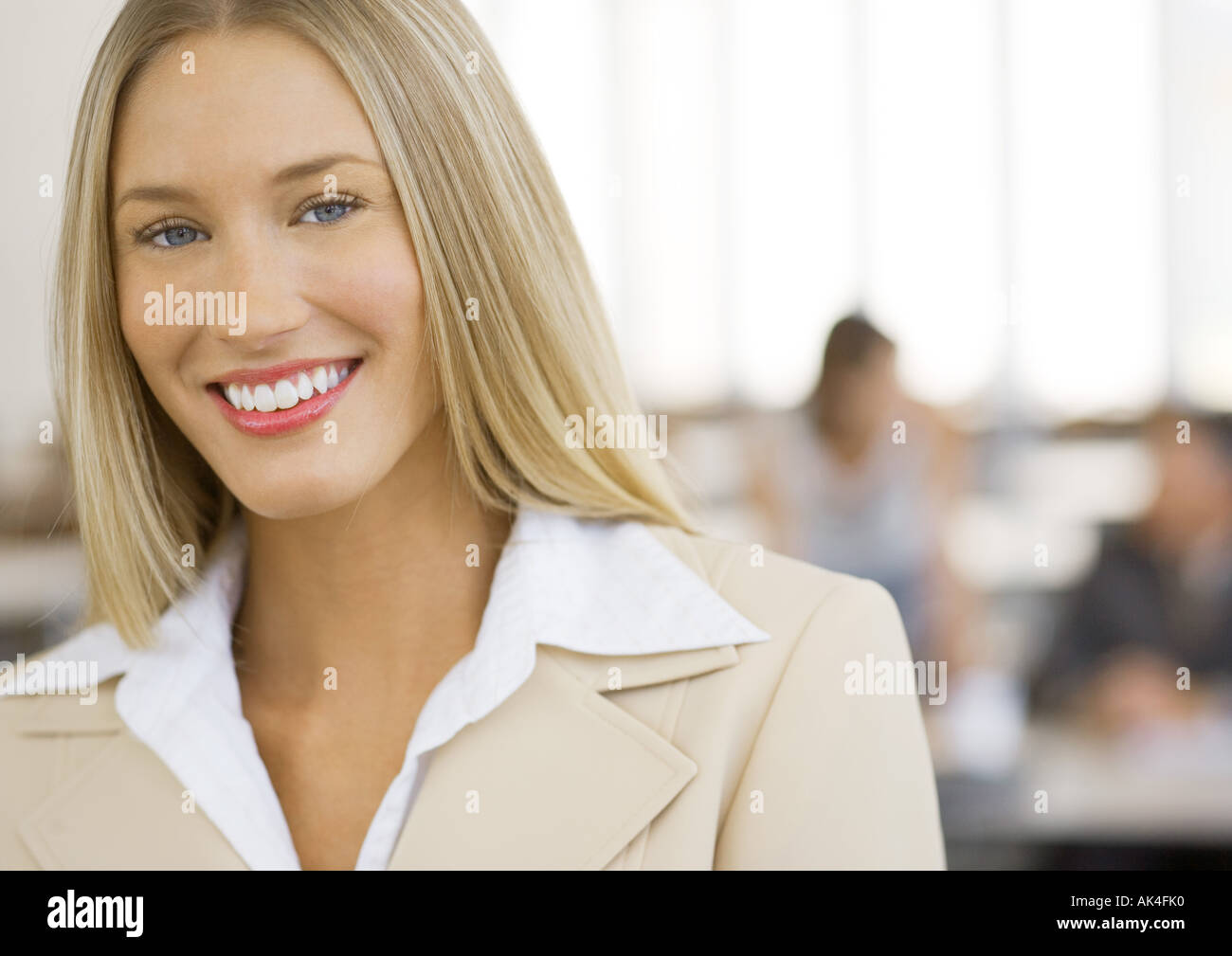 Young businesswoman smiling, portrait - Stock Image