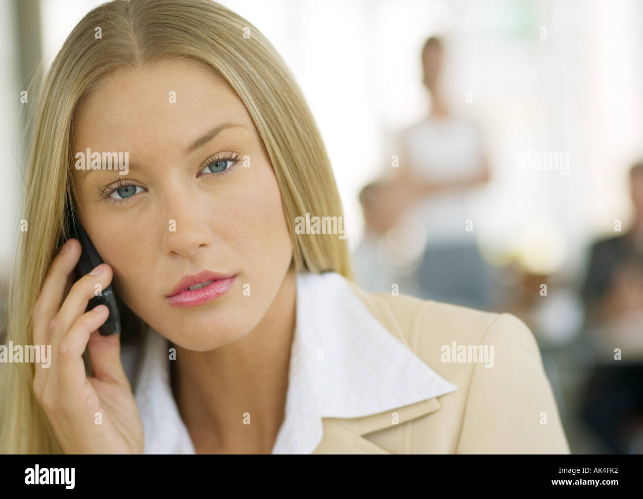 Young businesswoman using cell phone - Stock Image