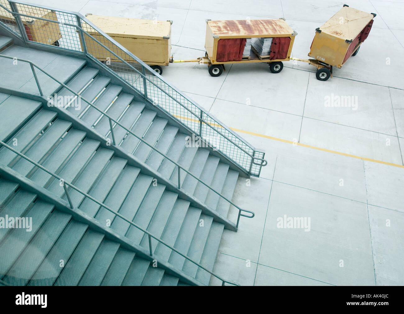Stairs and cargo containers on tarmac - Stock Image