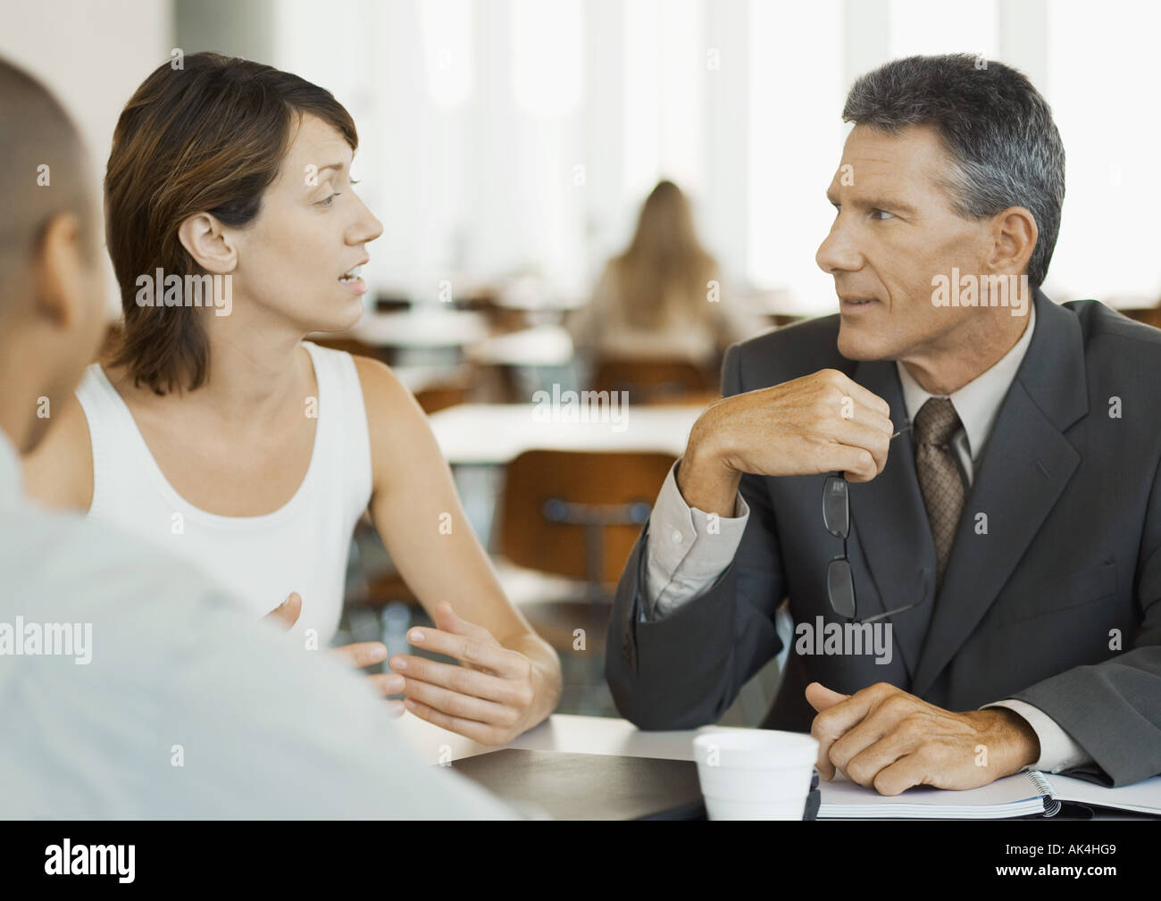 Business colleagues talking in cafeteria - Stock Image