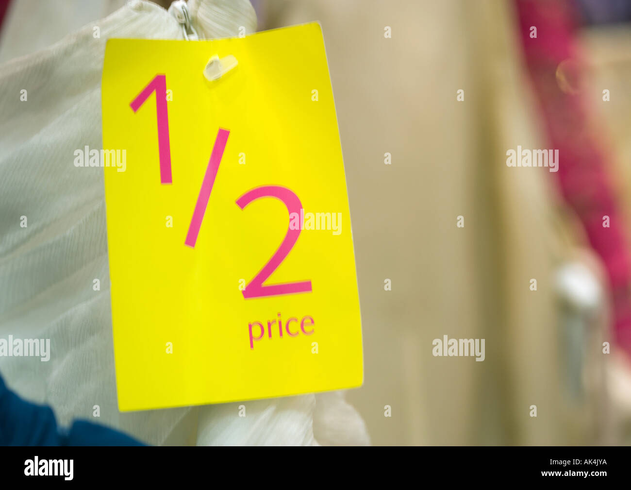 1/2 price tag on clothing, close-up - Stock Image