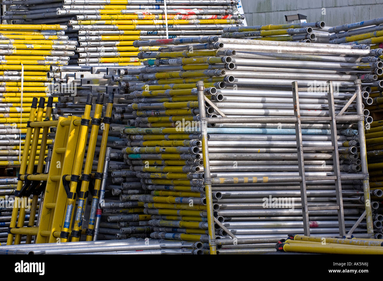 scaffolding piled up on construction site - Stock Image