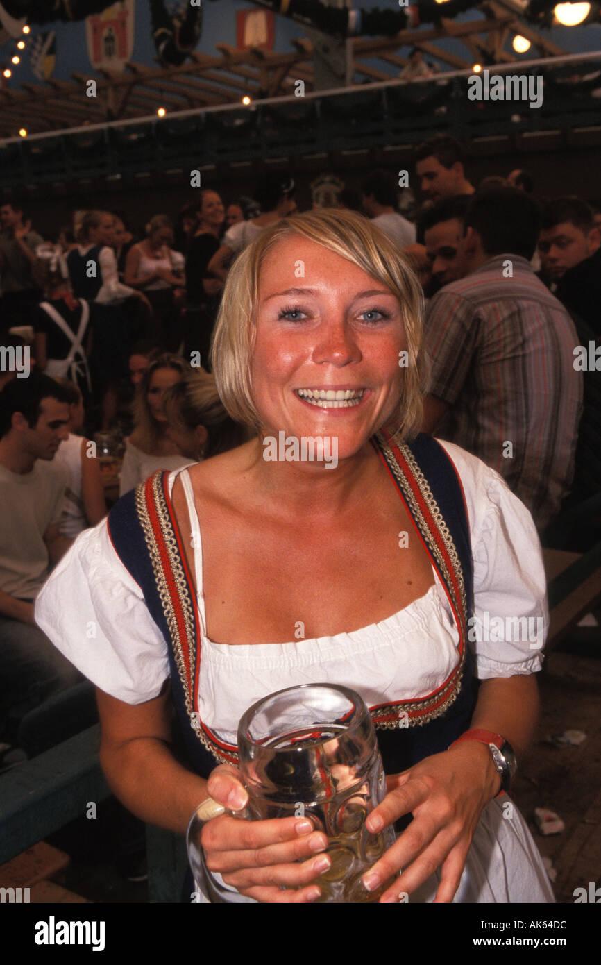 Germany, Munich, Oktoberfest, Woman in beer hall Stock Photo