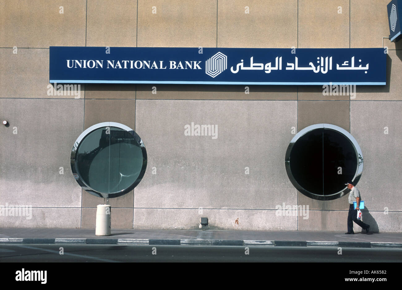 4th April 2003 A man walks past a branch of the Union National Bank in the city of Dubai United Arab Emirates  Stock Photo
